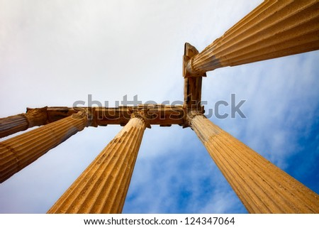 Looking towards the sky at columns in Side Turkey - stock photo