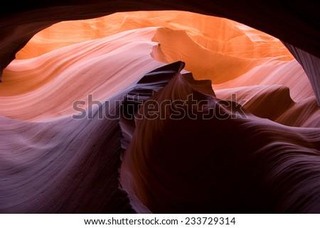 Looking up along a ridge and natural arch, Lower Antelope Canyon, Northern Arizona, USA - stock photo