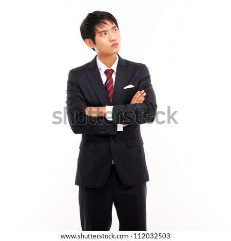 Looking up Asian business man isolated on white background.