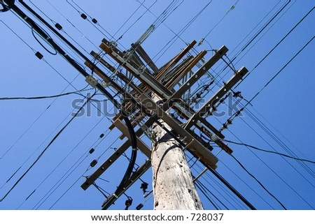 Looking up at a very tall power poll. - stock photo