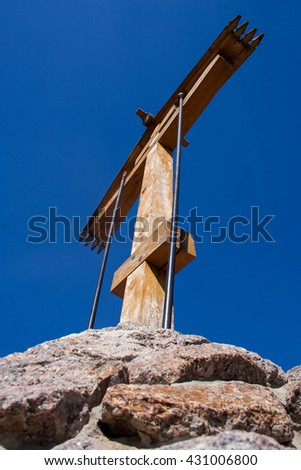 Looking up at a wooden cross and a beautiful blue sky - stock photo
