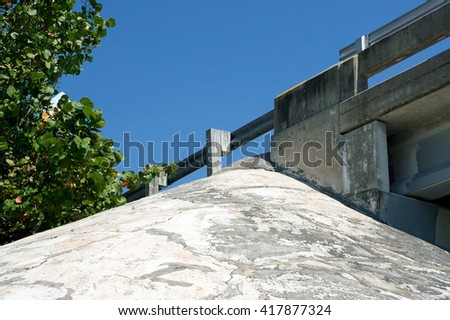 Looking up at bridge overpass railing with copy space - stock photo