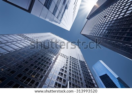 Looking up at business buildings in downtown New York, USA - stock photo