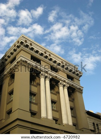 Looking up at columns and facade of bank building