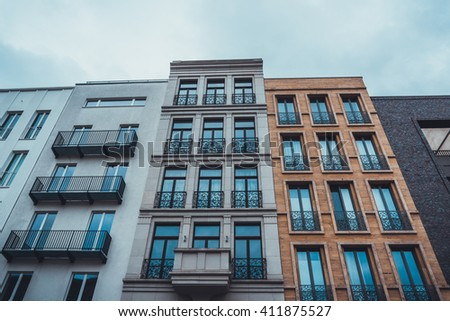 Looking Up at Modern Luxury Row Houses and Condominiums with Elegant Balcony Railings on Overcast Day with Cloudy Sky in Berlin, Germany Urban Neighborhood