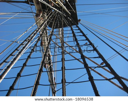 looking up at ship mast with ropes and knots