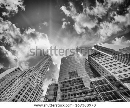 Looking up at Skyscrapers in Financial District at sunset. - stock photo