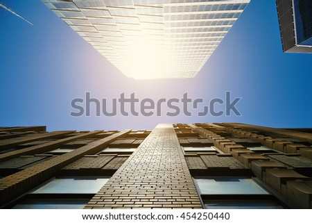 Looking up at skyscrapers in Lower Manhattan, New York City - stock photo