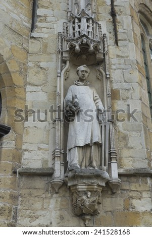 Looking up at statue of Town Hall or Stadhuis. Burg Square, Bruges, West Flanders, Belgium, Europe