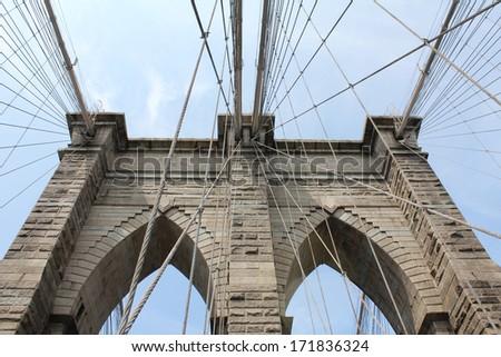 Looking Up at the  Brooklyn Bridge, - stock photo