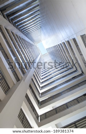 Looking up city building - stock photo