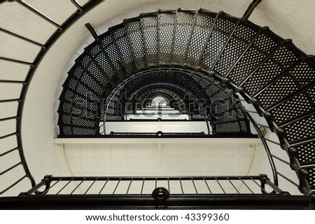 Looking Up Lighthouse Spiral Staircase - stock photo