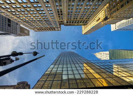 Looking up Manhattan Midtown skyscrapers, New York City - stock photo