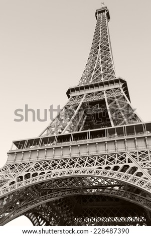Looking up on Eiffel Tower, the most popular landmark of Paris, France. Monochrome vertical photo