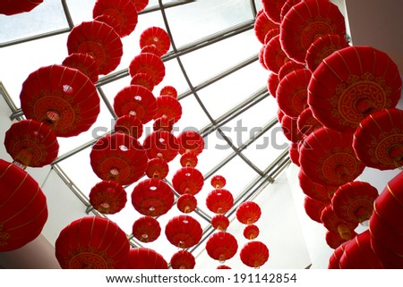 Looking up red Chinese lanterns in Interior - stock photo