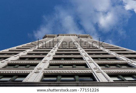 Looking up the facade of a terracotta office building - stock photo