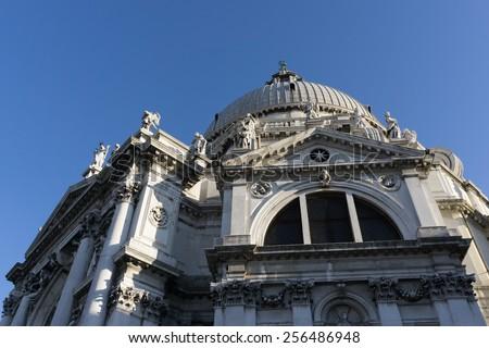 Looking up the santa maria della salute basilica  in venice, italy - stock photo
