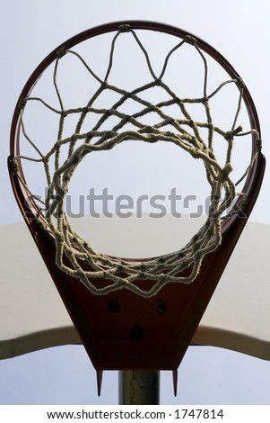 Looking up through the net of a basketball hoop - stock photo