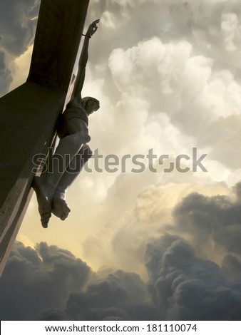 Looking upward into these dramatic storm clouds behind Jesus on the Cross represents Jesus Crucifixion on Good Friday and Rising again on Easter Sunday - stock photo