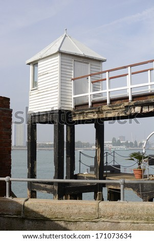 Lookout hut at entrance to Portsmouth Harbour. Hampshire. England. Haslar in background - stock photo