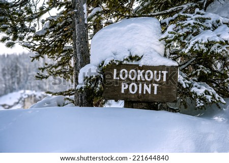 Lookout Point sign in winter at Yellowstone National Park with copy space in snow - stock photo