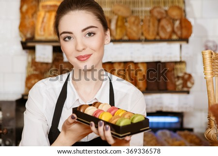 Looks yummy! Closeup shot of a fruit cake in the bakery baker standing on the background - stock photo