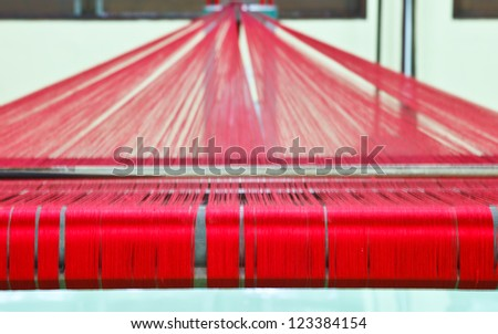 Loom for weaving silk in Thailand - stock photo