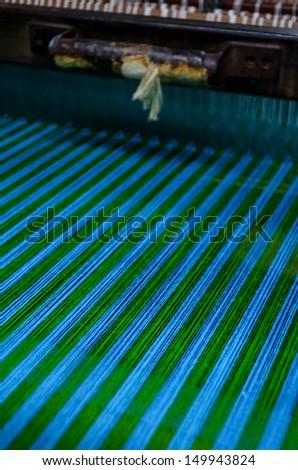 loom thread - stock photo