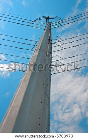 Looming Energy - electric power pole looms over viewer