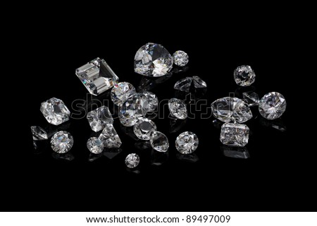 Loose diamond parcel on black background - stock photo