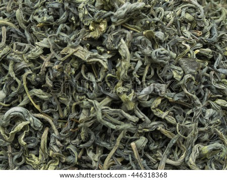Loose green tea leaves useful as a background - stock photo