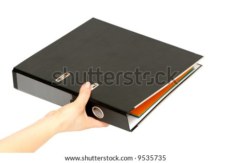 loose-leaf binder in hand isolated on a white background.
