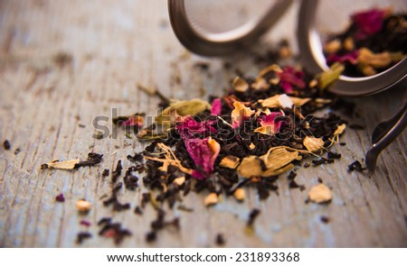 Loose Leaf Black and Herbal Tea with Metal Ball Infuser - stock photo