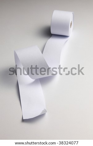 loosen paper from roll of the paper on the plain background - stock photo
