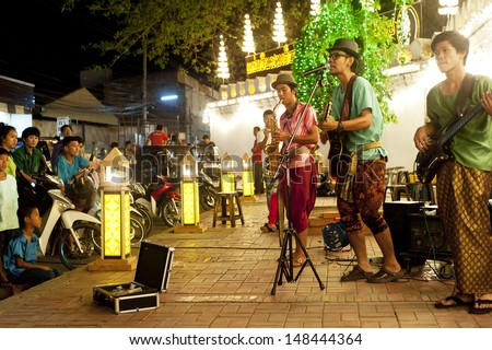 LOPBURI, THAILAND - FEB 23: Unidentified street musicians performing during the land of King Narai festival on Feb 23, 2013 in Lopburi, Thailand - stock photo