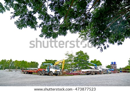 LOPBURI-THAILAND-JULY 16 : A loader & truck at warehouse on July 16, 2015 Lopburi Province, Thailand