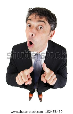 Loquacious argumentative persuasive businessman pointing his fingers and looking up at the camera with his mouth open speaking as he strives to make his point, high angle humorous portrait on white - stock photo
