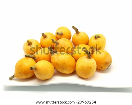 Loquats on white plate isolated on white background   - stock photo