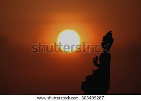 lord Buddha silhouette at sunset
