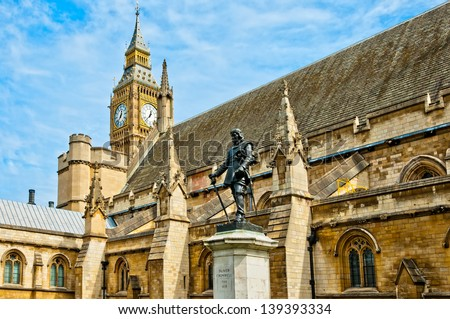 Lord Oliver Cromwell statue outside Palace of Westminster, Houses of Parliament, with Big Ben in the background. London, UK - stock photo