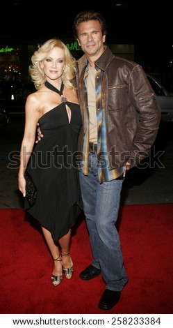 """Lorenzo Lamas and Barbara Moore attend the Warner Bros World Premiere of """"Firewall"""" held at the Grauman's Chinese Theatre in Hollywood, California on February 2, 2006 .  - stock photo"""