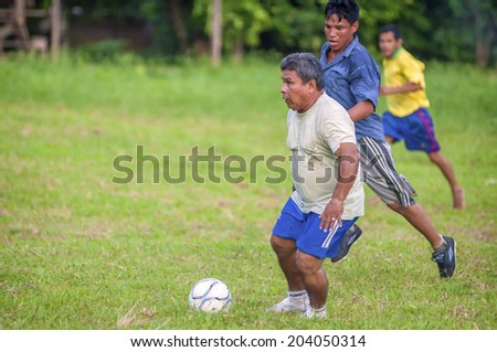 LORETO, PERU - JANUARY 02: Unidentified locals playing football in a small village in the middle of the Amazon Rain Forest, on January 02, 2010 in Loreto, Peru.