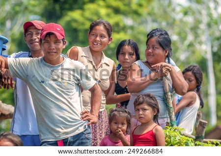LORETO, PERU - JANUARY 02: Unidentified locals posing for camera in a small village in the middle of the Amazon Rain Forest, on January 02, 2010 in Loreto, Peru.  - stock photo