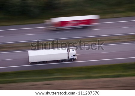 Lorries on a country road - stock photo