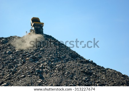 lorry delivering dumping rock  - stock photo