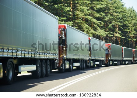 Lorry trucks cars in traffic jam at border zone custom - stock photo