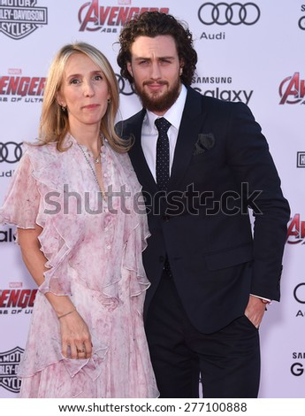 "LOS ANGELES - APR 14:  Aaron Taylor-Johnson & Sam Taylor-Johnson arrives to the Marvel's ""Avengers: Age of Ultron"" World Premiere  on April 14, 2015 in Hollywood, CA                 - stock photo"