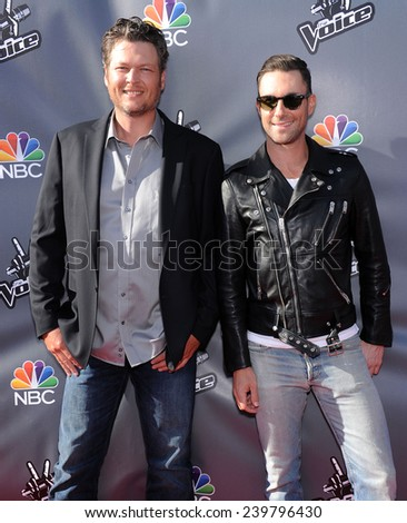 LOS ANGELES - APR 03:  Blake Shelton & Adam Levine arrives to the 'The Voice Celebrtaes Season 5  on April 03, 2014 in Hollywood, CA                 - stock photo