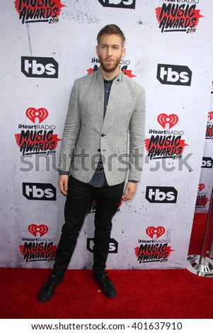 LOS ANGELES - APR 3:  Calvin Harris at the iHeart Radio Music Awards 2016 Arrivals at the The Forum on April 3, 2016 in Inglewood, CA - stock photo
