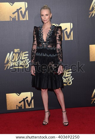 LOS ANGELES - APR 09:  Charlize Theron arrives to the Mtv Movie Awards 2016  on April 09, 2016 in Hollywood, CA.                 - stock photo